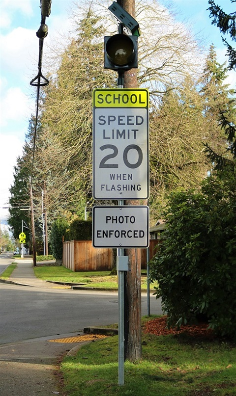 Speed Limit 20 when flashing sign with photo cameras on N.E. 80th Street in Kirkland