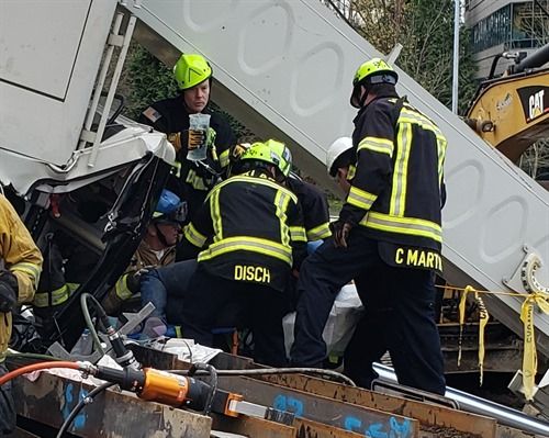 firefighters at crane accident