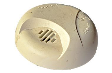 old smoke detector on white background